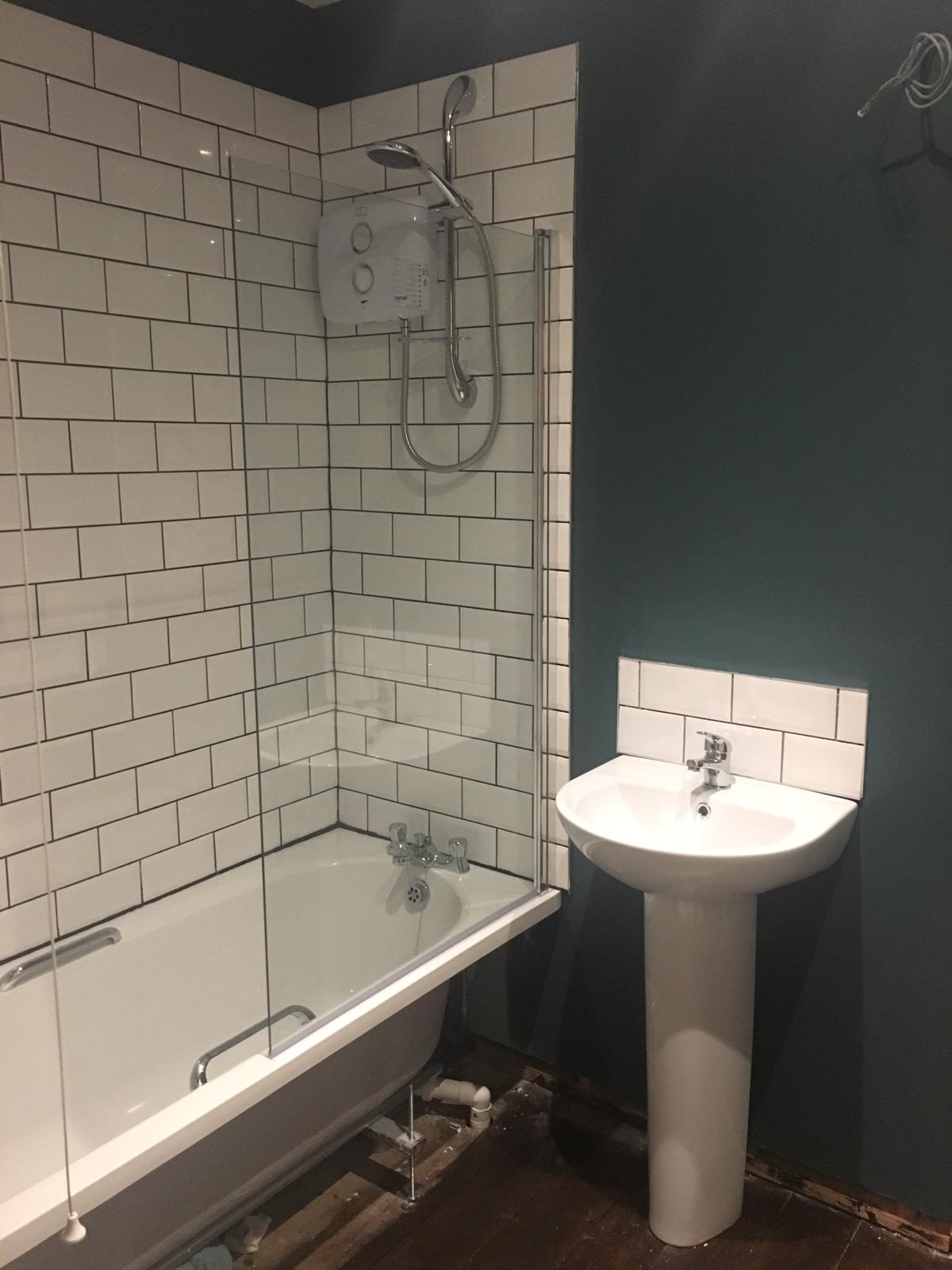 Shower refitted and sink installed
