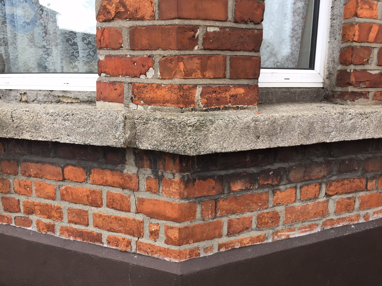Natural granite on a neighbours window sill